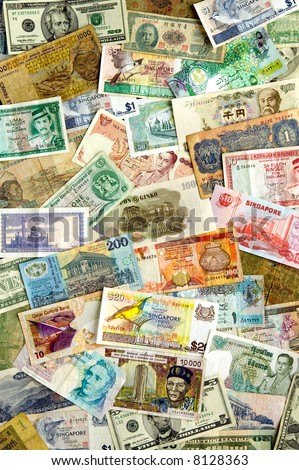 A collection of various currencies from countries spanning the globe. - stock photo