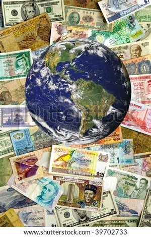 A collection of various currencies from countries spanning the globe.  Earth image courtesy of NASA. - stock photo