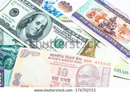 a collection of various currencies from countries the globe - stock photo