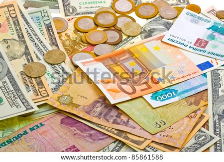 A collection of various money to background. Isolated on white. - stock photo
