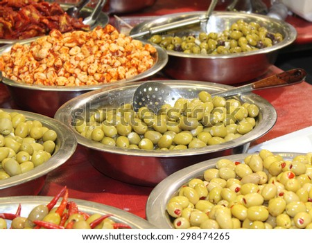 A Collection of Various Olives Displayed for Sale. - stock photo