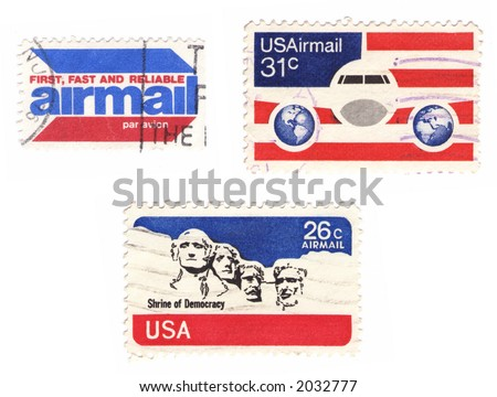 A collection of vintage US stamps: airmail, flag, Mt.Rushmore... - stock photo