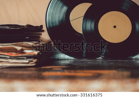 A collection of vinyl records. vintage toning - stock photo