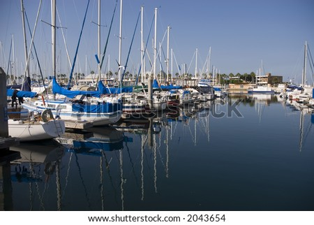 a collection of yachts and sailboats in a harbor - stock photo
