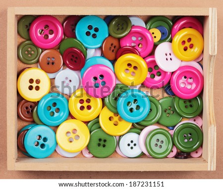a collection with many buttons of different colors and sizes in a box - stock photo