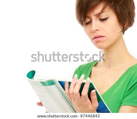 A college girl reading a book, isolated on white - stock photo