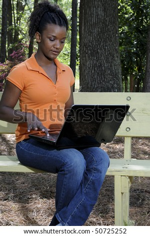 A college student working on a laptop - stock photo