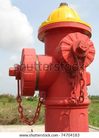 A color fire water pole against sunshine - stock photo