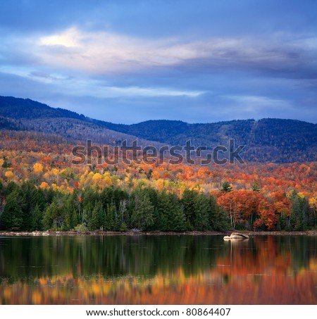A Colorful And Pastoral Mountain Lake Scene On An Autumn Evening, Loon Lake, Adirondack Mountains, New York - stock photo