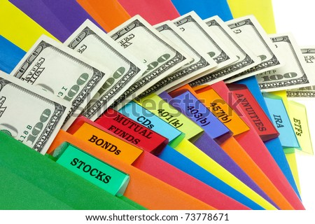 A colorful array of folders with the titles of a financial portfolio. - stock photo