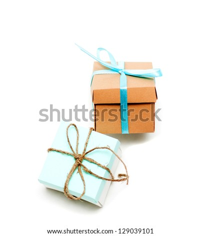 A colorful assortment of small gifts tied with bows - stock photo