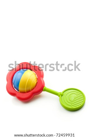 A colorful baby rattle isolated on a white vertical background with copy space
