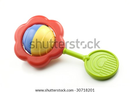 A colorful baby rattle isolated on white with copy space - stock photo