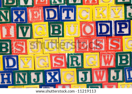A colorful background of baby blocks, with the word success in the middle