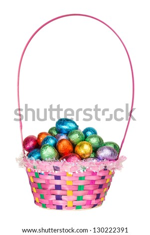 A Colorful Basket full of Chocolate Easter Eggs - stock photo