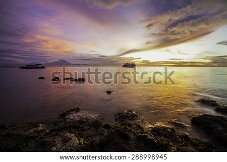 A colorful beach during sunrise with amazing cloud on the sky, Photo taken in Bali. - stock photo