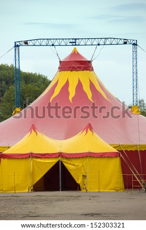 A colorful circus tent, entrance open