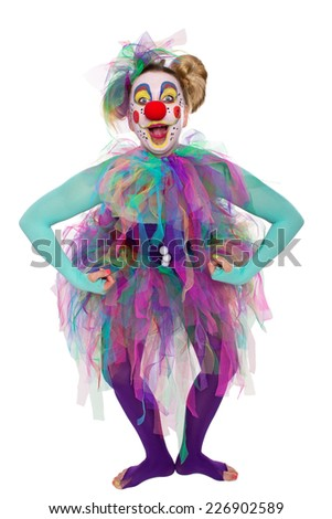 A colorful clown posing and looking in to the camera - stock photo