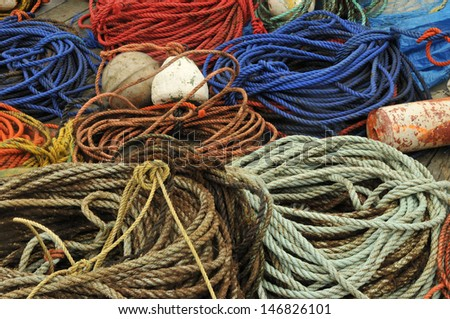 A colorful collage of ropes and buoys on the dock at Peggy's Cove, Nova Scotia