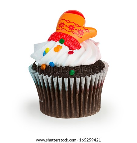 A colorful cupcake with toy mitten on top, isolated