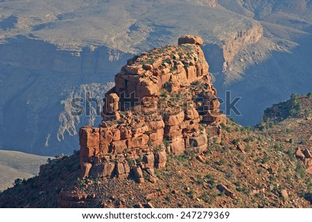 A colorful eroded rock formation in the South Rim of Grand Canyon National Park in Arizona, USA  - stock photo