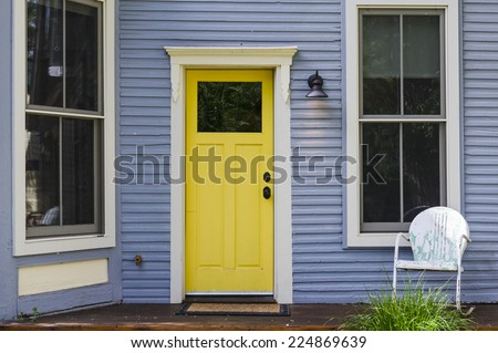 a colorful front door on an old house - stock photo