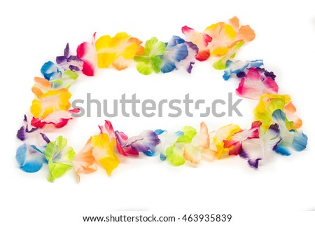 A colorful Hawaiian flower necklace - lei - with bright colorful flowers made of plastic. Studio shot on white with shadows and space for your copy text