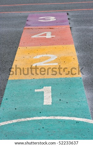 A colorful hopscotch game painted on a playground - stock photo