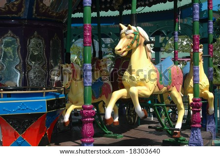 Colorful horse as part of a vintage merry go round for children on a