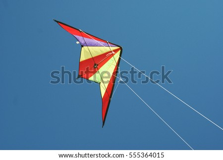 A colorful kite flying in the blue sky