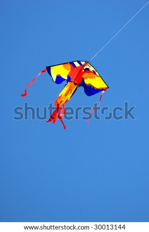 A colorful kite flying in the clear blue sky