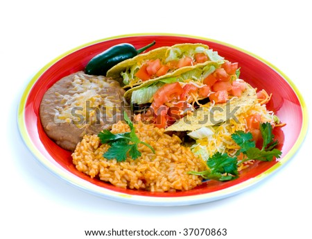A colorful Mexican food plate with tacos, bean and rice - stock photo