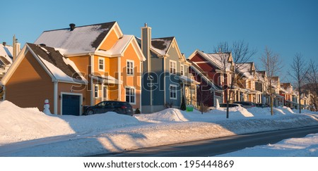A colorful neighborhood in winter, Quebec, Canada - stock photo