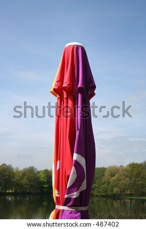 A colorful parasol against a blue sky