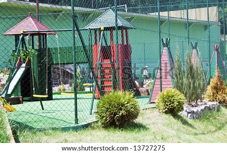 A colorful playground in a park - stock photo