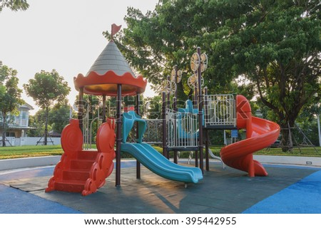 A colorful public playground in a garden - stock photo