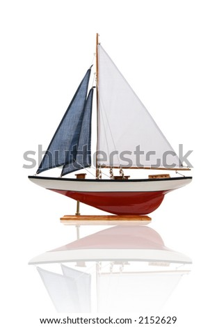 A colorful sailboat isolated over white with reflection - stock photo