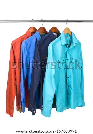 A colorful shirts on metal hanger, isolated - stock photo