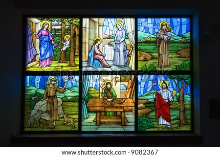A colorful six pane stained glass church window - stock photo
