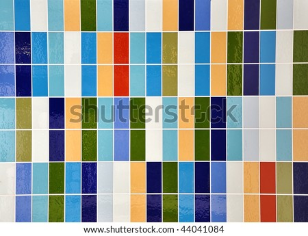 A colorful square rectangle tile pattern with shine. Colors include green, blue, peach and white. Use it for home decor or a texture pattern. - stock photo