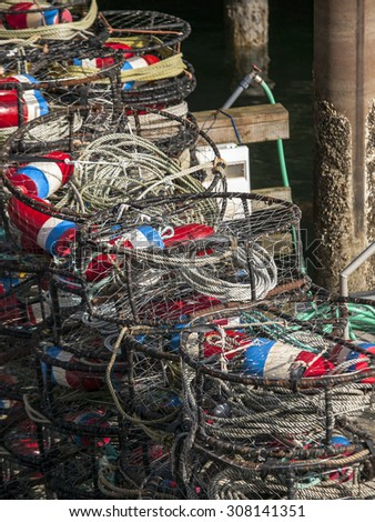 A colorful stack of crab traps waiting to be taken back out into the sea. - stock photo