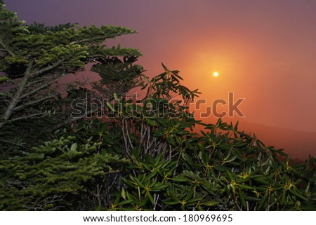A colorful sunset in the Blue Ridge Mountains of Western North Carolina. - stock photo