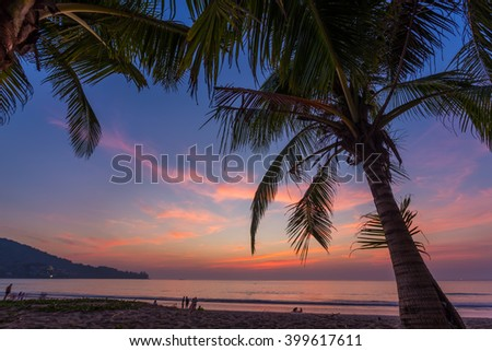 A colorful sunset on Kamala beach in Phuket Thailand - stock photo
