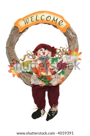 A colorful Thanksgiving wreath with scarecrow isolated over white - stock photo