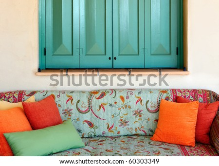 A colorful traditional sofa in the porch of a Greek island house - stock photo