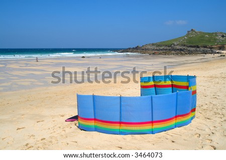 A colorful windbreak on Porthmeor beach, St. Ives, Cornwall, UK. - stock photo