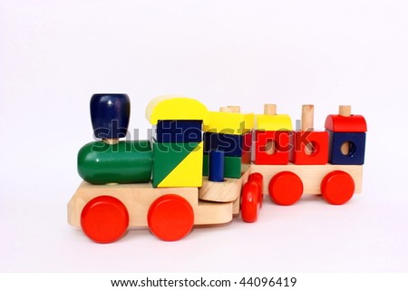 A colorful wooden train toy for children, isolated