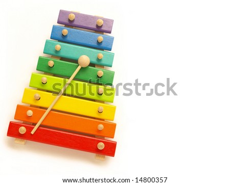 a colorful, wooden xylophone with mallet over white - stock photo