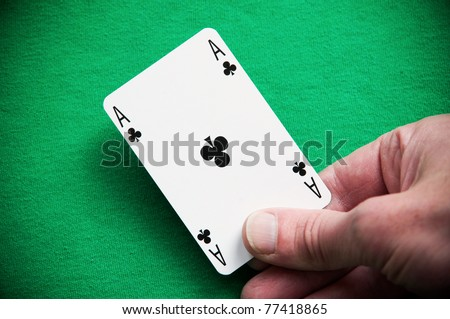 A Colouful Photo of Someone Dealing an Ace Playing Card