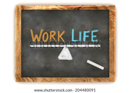 A Colourful 3d Rendered Concept Illustration showing a balance between work and life, written on a blackboard - stock photo
